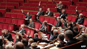 Members of the French National Assembly vote on the genocide bill