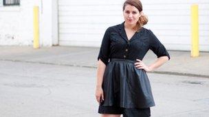 A woman in a shirt dress