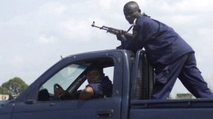 Armed Congolese police officers patrol the streets of Kinshasa, Democratic Republic of Congo, 10 December 2011