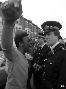 PA file photo dated 10/07/1981 of a youth confronting a senior police officer during the Brixton riots.