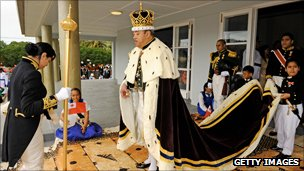 King in robes as part of crowning ceremony