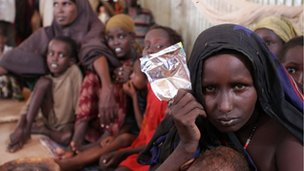 Refugee Fatuma Abdille (R) poses at the Transit Centre in Dolo Ado, Ethiopia, on December 15, 2011. Over 300,000 refugees have fled severe drought, conflict and famine in southern Somalia this year into Ethiopia and Kenya, according to the United Nations
