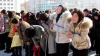 Handout picture taken by North Korea's official Korean Central News Agency shows people crying for late North Korean leader Kim Jong-il in South Pyongan province