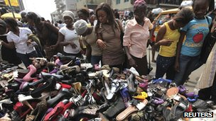 Women shop for shoes in Balogun market, in the central business district of Lagos, 22 December 2011