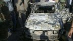 A damaged car is seen at the site of a car bomb attack in Damascus, in this handout photograph released by Syria's national news agency SANA (23 December 2011)