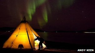 Tent with aurora visible