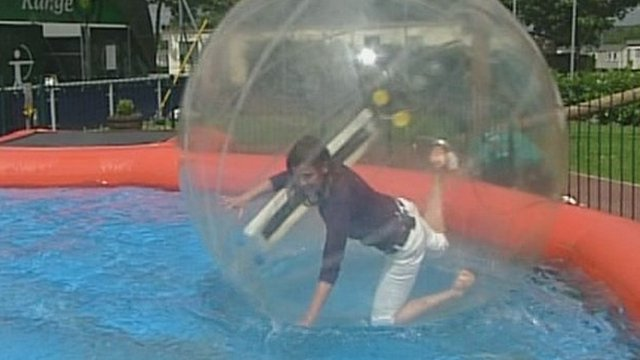 BBC South Today weather presenter Alexis Green in a giant plastic ball