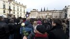 People watch funeral on big screen at Prague Castle