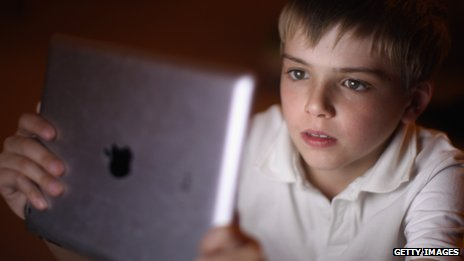 A young boy uses an iPad