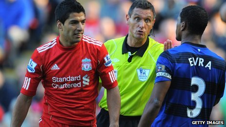 Liverpool's Luis Suarez (left) and Manchester United's Patrice Evra during the game in October