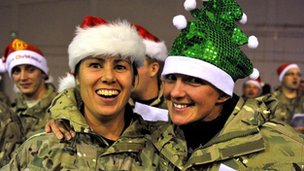 Troops holding a carol service at Camp Bastion, Afghanistan