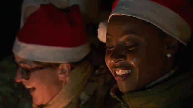 British service women singing carols in Camp Bastion