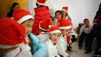 Children rest after singing Christmas songs in Beijing, China, 24 December