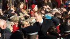 Prince William surrounded by well-wishers
