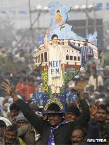 A supporter holds a cutout of the map of India with images of Mayawati, the chief minister of the northern Indian state of Uttar Pradesh
