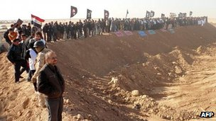 Iraqi demonstrators protest outside Camp Ashraf, home to exiled Iranian opposition members, in the western Diyala province calling for the camp to be closed and for its residents to be deported on December 9, 2011.