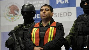 "Felipe Cabrera Sarabia, alias ""El Inge,"" is shown to the press under the custody of army soldiers at the federal organized crime investigations headquarters (SIEDO) in Mexico City"