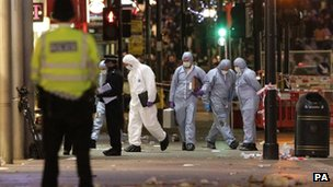 A general view of police at the scene on Oxford Street where a man was stabbed to death today