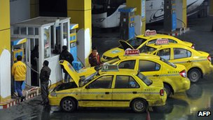 Taxis getting fuel at a petrol station in China