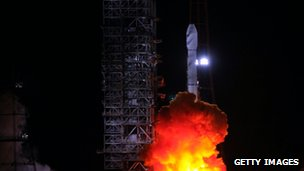 A satellite carrying rocket blasts off from the Xichang Satellite Launch Centre