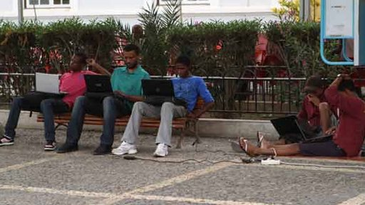 Men using laptops in the street