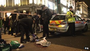 Police seal off Oxford Circus, with bloodied clothes on the road