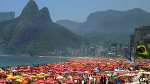 Thousands of people crowd Ipanema Beach in Rio de Janeiro, Brazil, on 22 December 2011