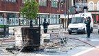 Police survey the damage in Tottenham. Photo: Michal Kulczynski