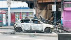 Burnt-out car. Photo: Michal Kulczynski