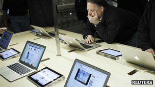 Shopper looks at Apple's laptops