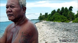 Fisherman watches the tide from the shore of Funafuti Atoll