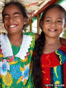 Two Tuvaluvian girls smiling