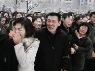 State television pictures showing mourners crying during a funeral procession for Kim Jong-il (28 December 2011)