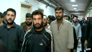 A handout picture released by the Syrian Arab News Agency (Sana) shows prisoners being released from an unidentified prison in Damascus (30 November 2011)