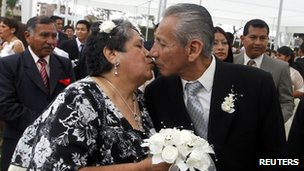 Carmen Mercado 64, and Jorge de la Cruz, 74 kiss after getting married