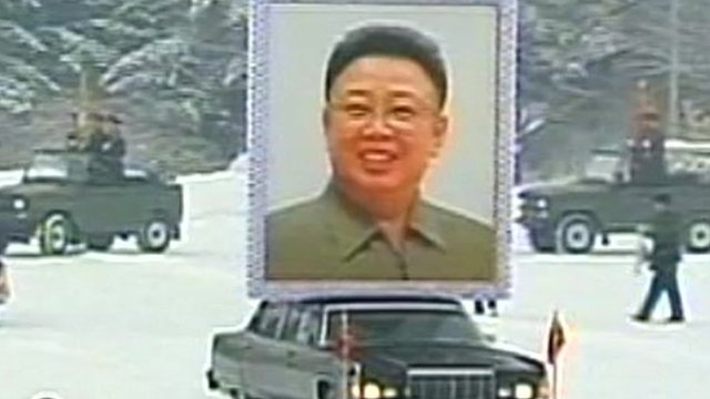 Car carrying picture of Kim Jong-il