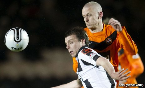 St Mirren's Paul McGowan and Scott Robertson of Dundee United