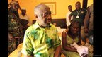 Ivory Coast's Laurent Gbagbo and his wife, Simone, sit on a bed at the Golf Hotel in Abidjan after their arrest on 11 April 2011