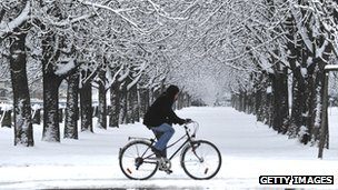 Person cycling in snow
