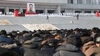 People take part in a three-minute silent tribute during a national memorial service to mourn late leader Kim Jong-il in Pyongyang, photo distributed by China's Xinhua News Agency, 29 December 2011