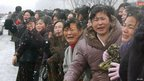 Women cry as Kim Jong-il's coffin approaches in Pyongyang (28 Dec 2011)