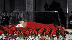 Kim Jong-il's body lies in state during his funeral at the Kumsusan Memorial Palace in Pyongyang, North Korea, in a KCNA picture from 28 December 2011 released on 29 December