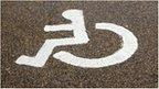 A painted sign in a parking bay for disabled parking only