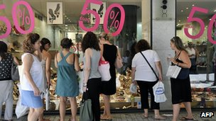 Customers outside a shop in Greece