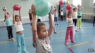 Children exercising in a school gym