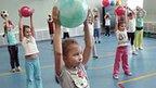 Children exercising in a school gym