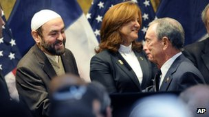 New York Mayor Michael Bloomberg (right) shakes hands with an imam at the interfaith breakfast on 30 December 2011