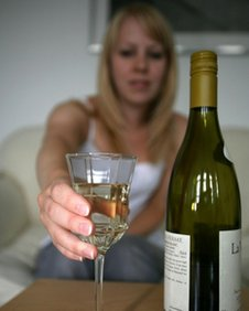 Woman drinks wine