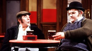Ronnie Corbett and Ronnie Barker sat at a pub table for a sketch