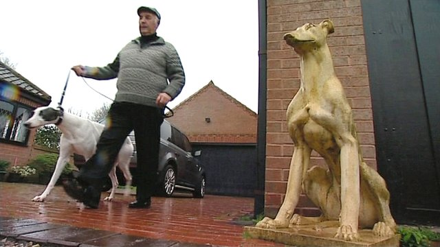 Man with his greyhound